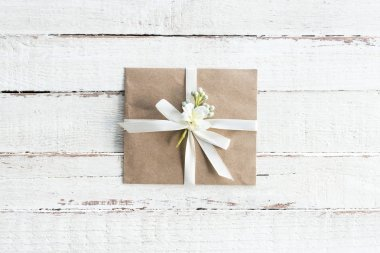 envelope with flower and ribbon