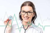 Fotografia medico con lo stetoscopio e cardiogram