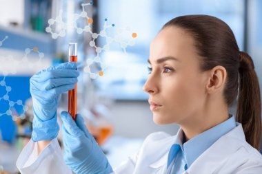 chemist with test tube in hands