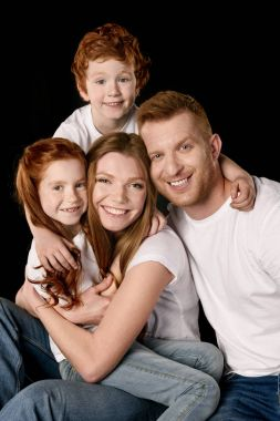 family in white t-shirts