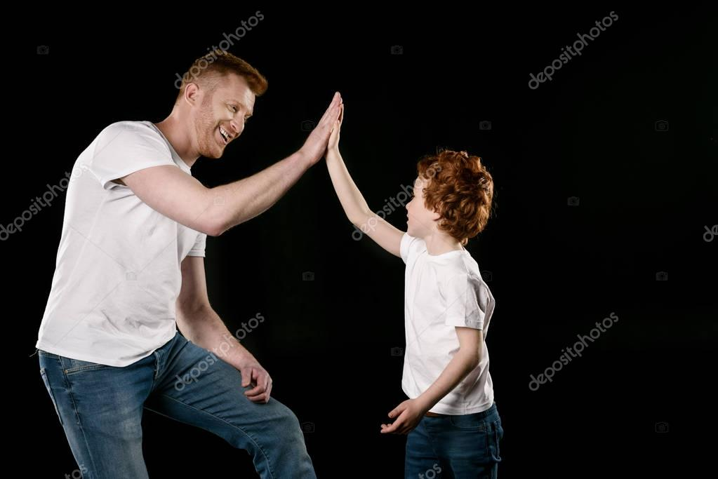 Father giving high five to son