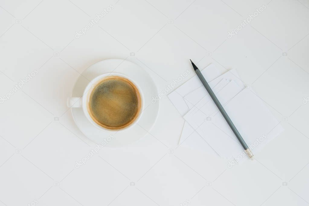 blank notes with pencil and cup of coffee