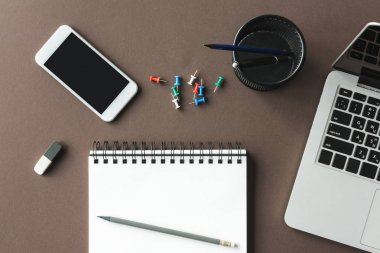 Notebook and smartphone at workplace