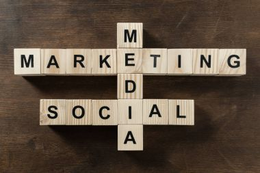Social media marketing word made from crossword on wooden surface stock vector