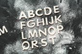 Fotografie dough for cookies in forms of letters