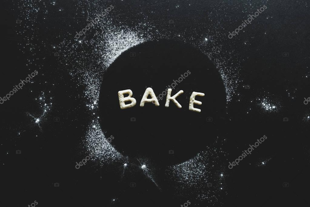 cookies in forms of letters with powdered sugar