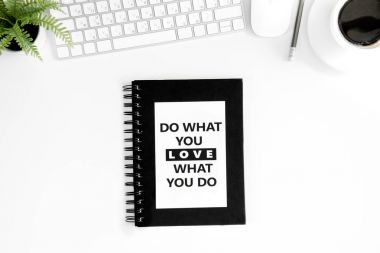 Flat lay with do what you love what you do motivational quote on diary, computer mouse and keyboard isolated on white stock vector