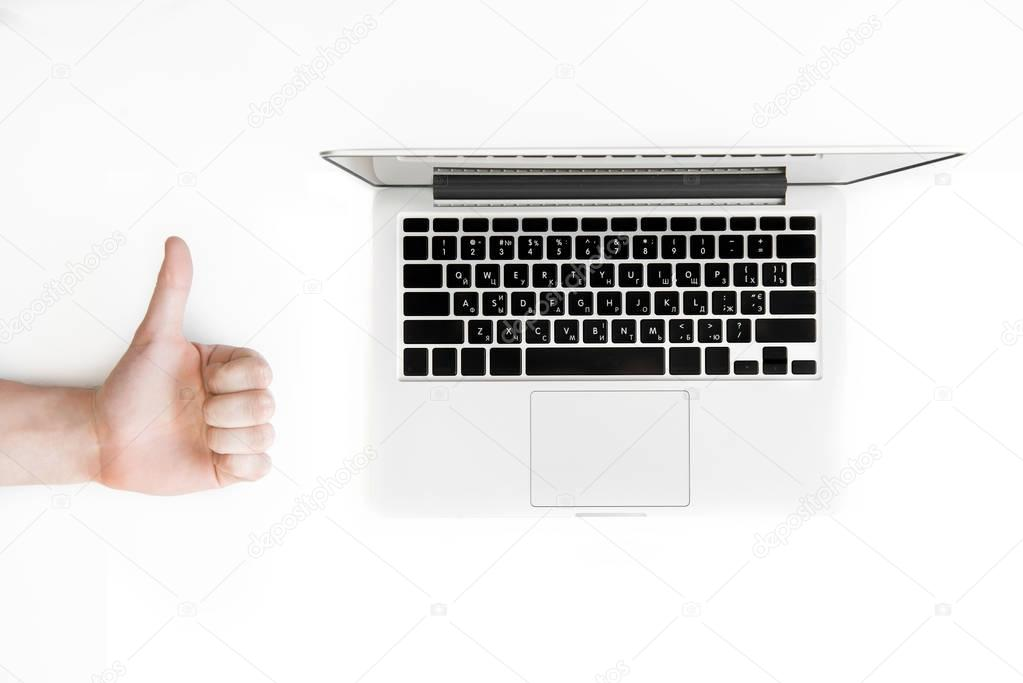 human hand and laptop