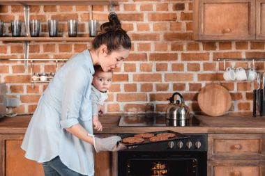 woman with her son baking cookies