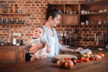 Mother with son in the kitchen
