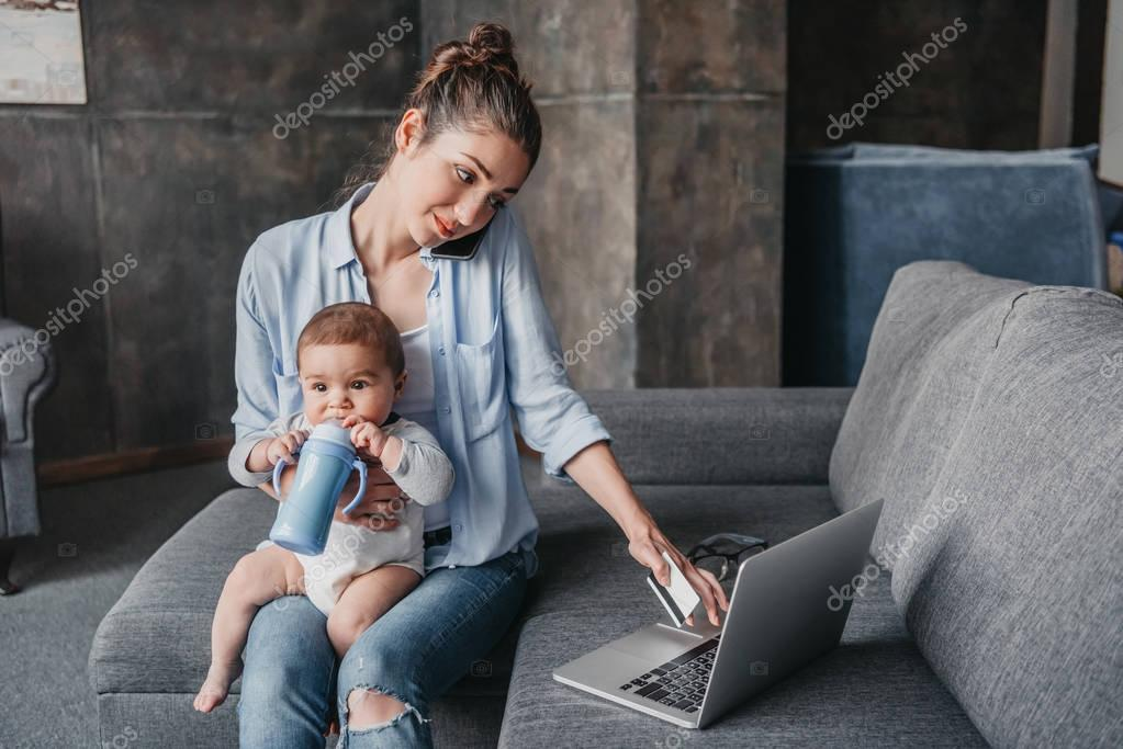 Mother with her son remote working