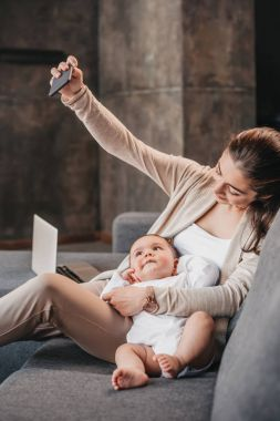 Mother with her son taking selfie on smartphone