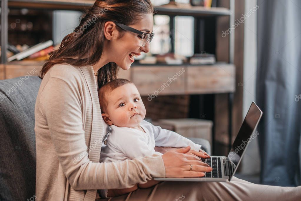 Mother with her son using laptop