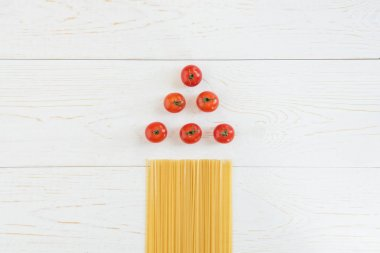 Tomatoes and raw pasta