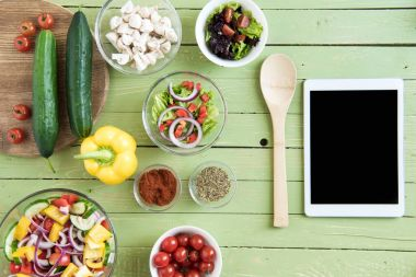 Fresh raw vegetables and digital tablet