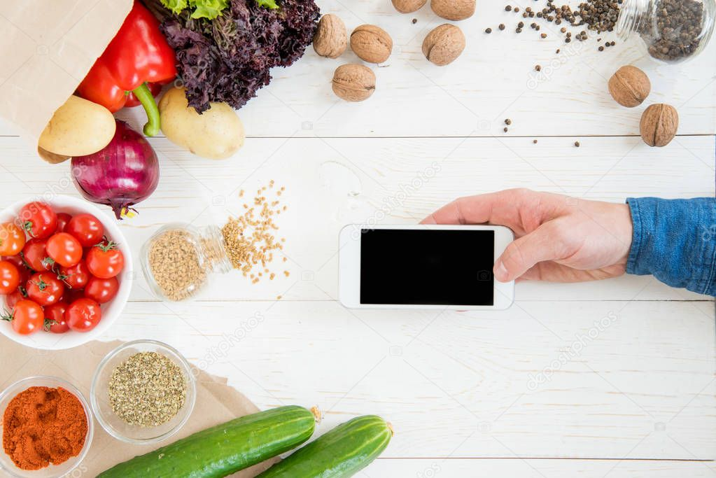 Person using smartphone while cooking