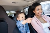 girl with mother in car