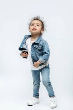 funny little kid girl in jeans