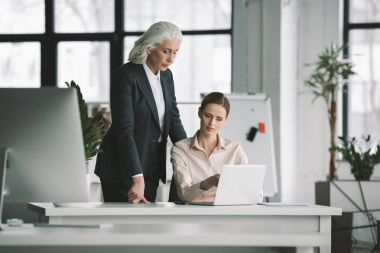 businesswoman and her boss working with laptop