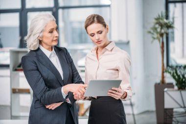 Businesswomen with digital tablet