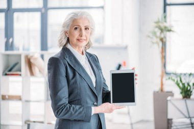 Senior businesswoman with digital tablet
