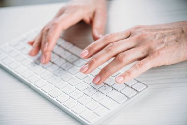 woman typing on keyboard