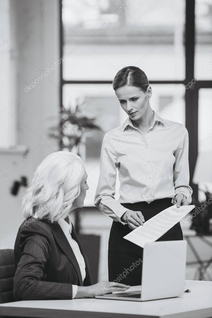 businesswoman and her boss working with documents