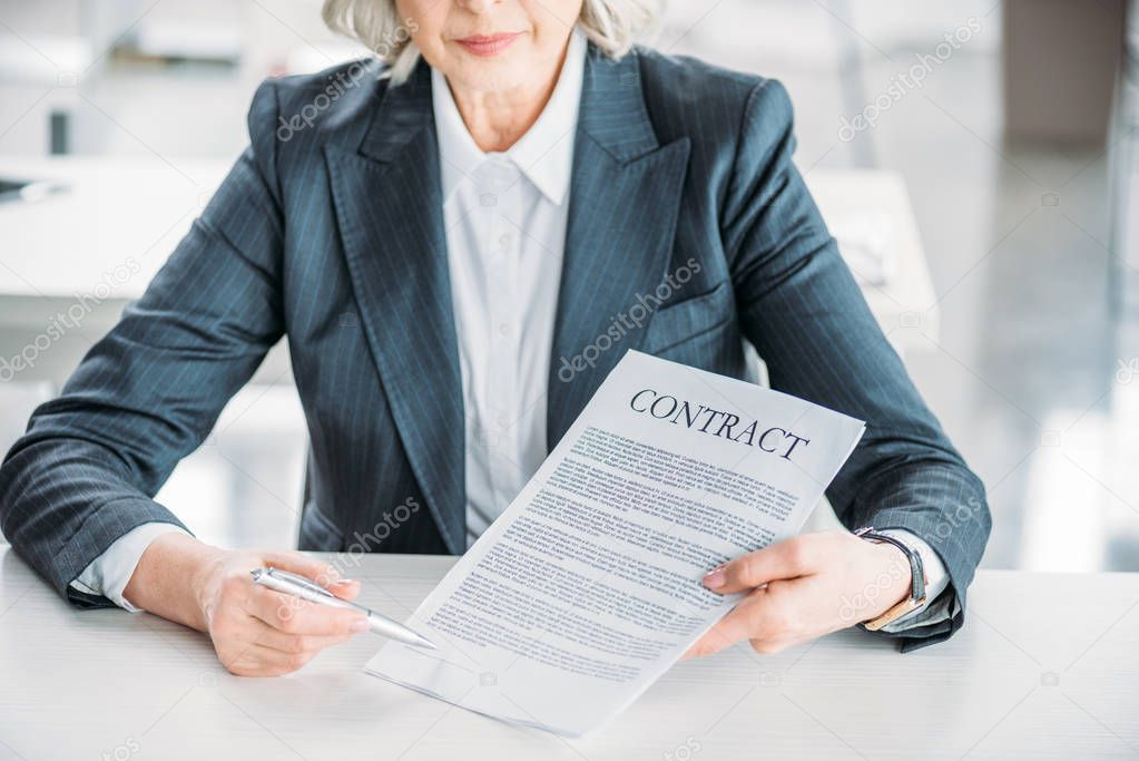 businesswoman pointing at contract