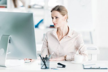 Young caucasian businesswoman working on computer at modern office stock vector