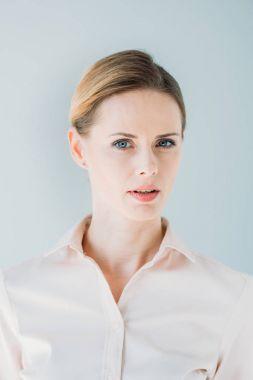 pensive caucasian businesswoman in formalwear