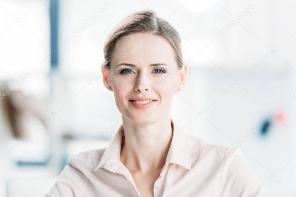 young smiling caucasian businesswoman