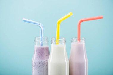Tasty milkshakes in glass bottles
