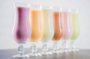 Delicious milkshakes in glasses