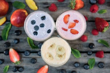 banana and berry milkshakes in glasses