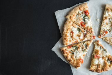traditional italian sliced pizza on parchment