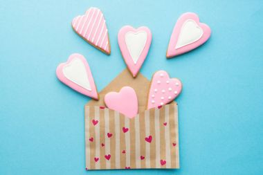 Open envelope with heart shaped cookies