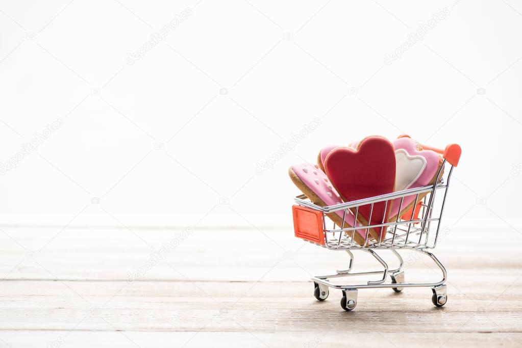 Shopping trolley full of heart shaped cookies with copy space stock vector