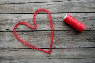 Heart sign made from thread