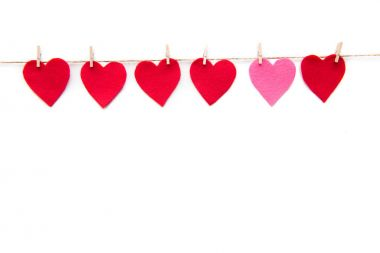 Red heart paper cut decorations hanging on clothespins isolated on white stock vector