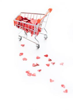 Full shopping trolley of red hearts isolated on white stock vector