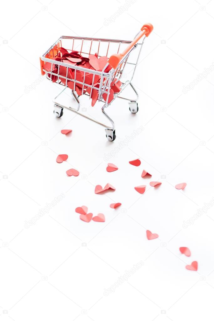 Shopping trolley full of red hearts