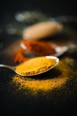 spices and herbs in metal spoon