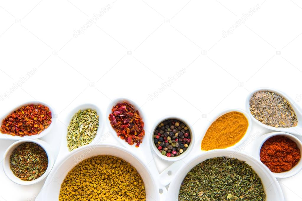 Spices in spoons and bowls