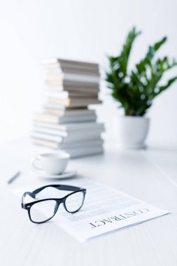 eyeglasses and business documents