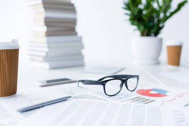 Composition with eyeglasses and business documents on white desk stock vector