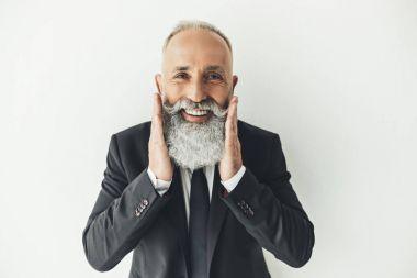businessman touching his beard