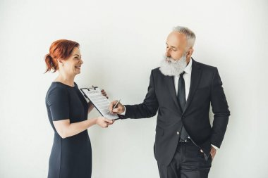 senior businessman signing contract