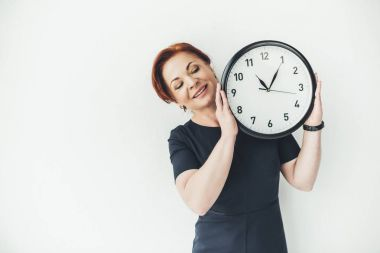 mature woman with clock