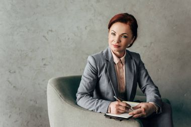 Mature businesswoman with notebook