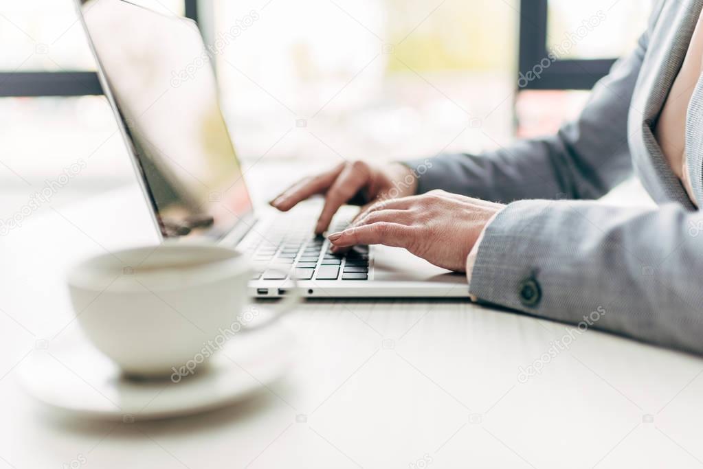 businesswoman typing on laptop